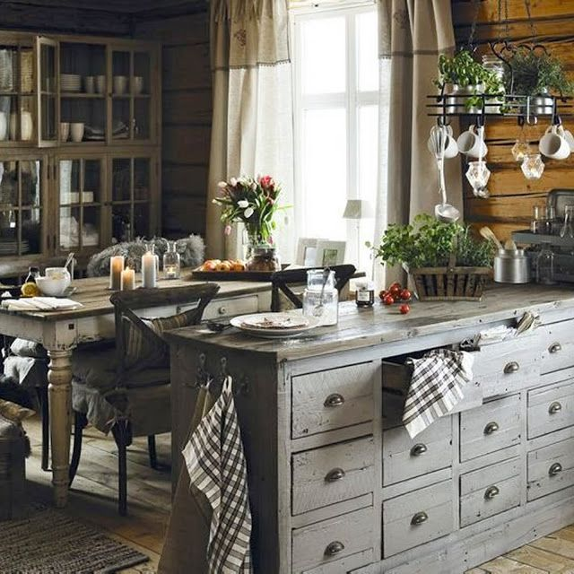 Old Log home kitchen - Love the cabinet full of small drawers and the cabinet with glass doors. Also, like the hooks on the end of the cabinet to hang dish towels. - Blogg Home and Cottage
