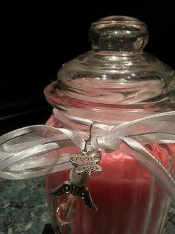 Candle In grooved jar with lid $22  Website:  www.purplebutterflydesigns42.weebly.com  Find us on Facebook: www.facebook.com/purplebutterflydesigns90  Find us on Instagram: http://instagram.com/purplebutterflydesigns