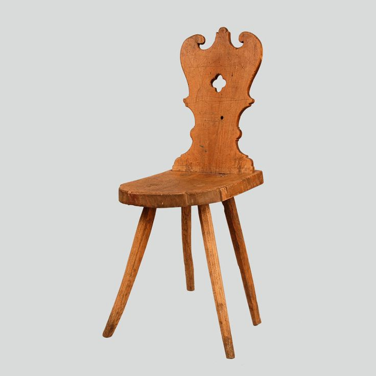 Wooden stool. Trapezium-shaped seat with conical legs fitted at obtuse angles. Heart-shaped back rest with cut out elements and openwork ornamentation.  Podhalanian Highlanders, Zakopane, early 20th c.
