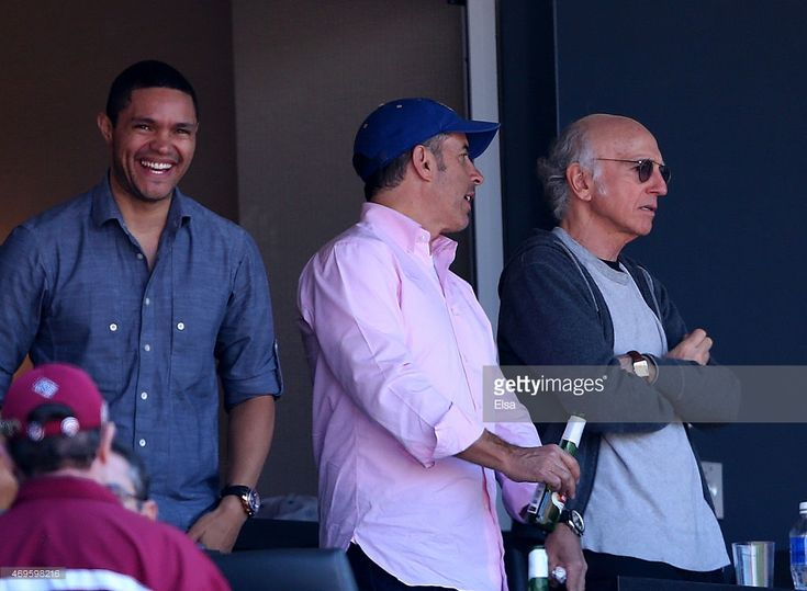 Trevor Noah, Jerry Seinfeld and Larry David watch the game between the New York Mets and the Philadelphia Phillies during Opening Day on April 13, 2015 at Citi Field in the Flushing neighborhood of the Queens borough of New York City.