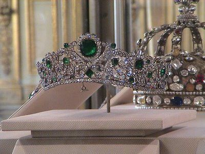 The tiara of Marie~Therese the only living child of Marie~Antoinette & Louis XVI. It is a beautiful Emerald and diamond tiara in a symmetrical design of scrolling foliage, mounted with over a thousand diamonds set in silver, and 40 emeralds set in gold.