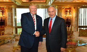 Donald Trump links Mexico border wall plan to Israel's 'successful' separation barrier Caption: US Republican presidential candidate Donald Trump meets Israeli prime minister Benjamin Netanyahu at Trump Tower in New York on Sunday.