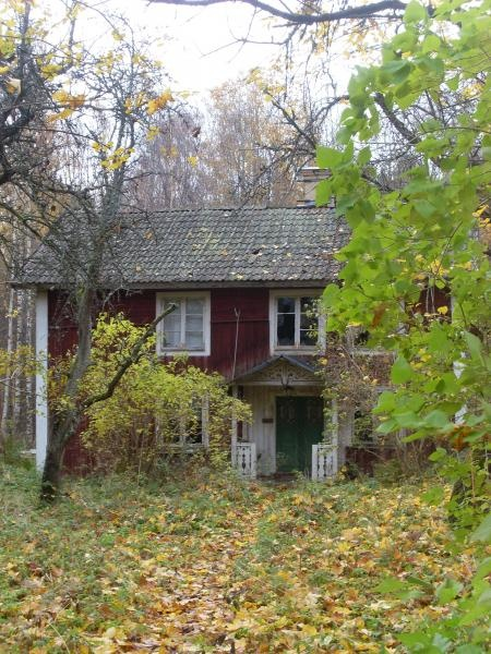 Abandoned old red house in the Swedish countryside for sale.