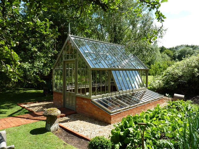 The perfect centrepiece to a Vegetable garden - Inspiration: cold frames south of greenhouse with interchangeable glass for starting and screens for protecting.