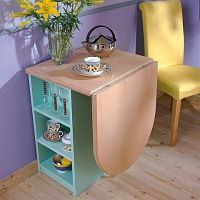 Compact table for two, plus storage. This would be great for a tiny house!