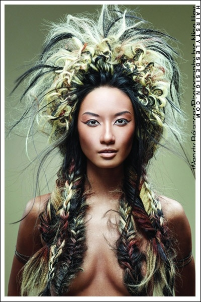 -  Large Native American Inspired Style with Fishtail Braids -    - Hair Style : Large and complicated, this hairstyle is the work of winner of the Contessa's Best Alberta Hairstylist, Wendy Belanger. The volume and fishtails add to the native feel to the whole head.  Hair Cut : Large and Braided with lots of volume.  Hair Colour : Black, Blonde and Red. -  http://www.hairstylesdesign.com/gallery/special_hairstyles_4268.php-
