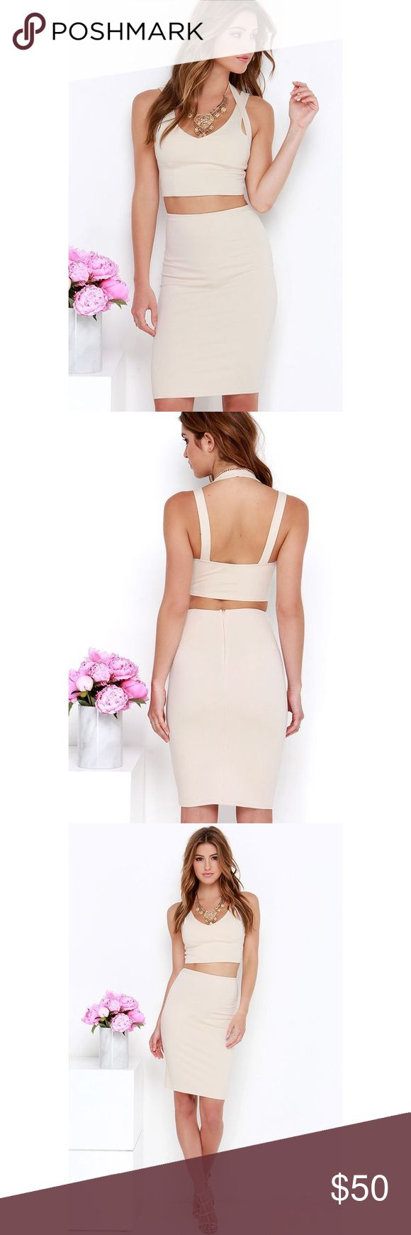 """Beige Two Piece dress Why hunt for two matching pieces, when the Piece Together Beige Two-Piece Dress does all the work for you?! Medium-weight stretch knit creates a sleek finish across tank straps and second halter strap, all atop the darted cropped bodice. Complete this sexy look with the bodycon pencil skirt. Hidden back zipper. Small top measures 14.5"""" long. Small bottom measures 22"""" long. Front of top is lined; skirt is unlined. 66% Rayon, 30% Nylon, 4% Spandex. Hand Wash Cold.    Worn…"""