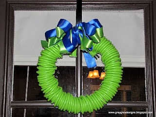 A honey-Do shower!! What a great idea! btw this is an extension cord as a wreath!