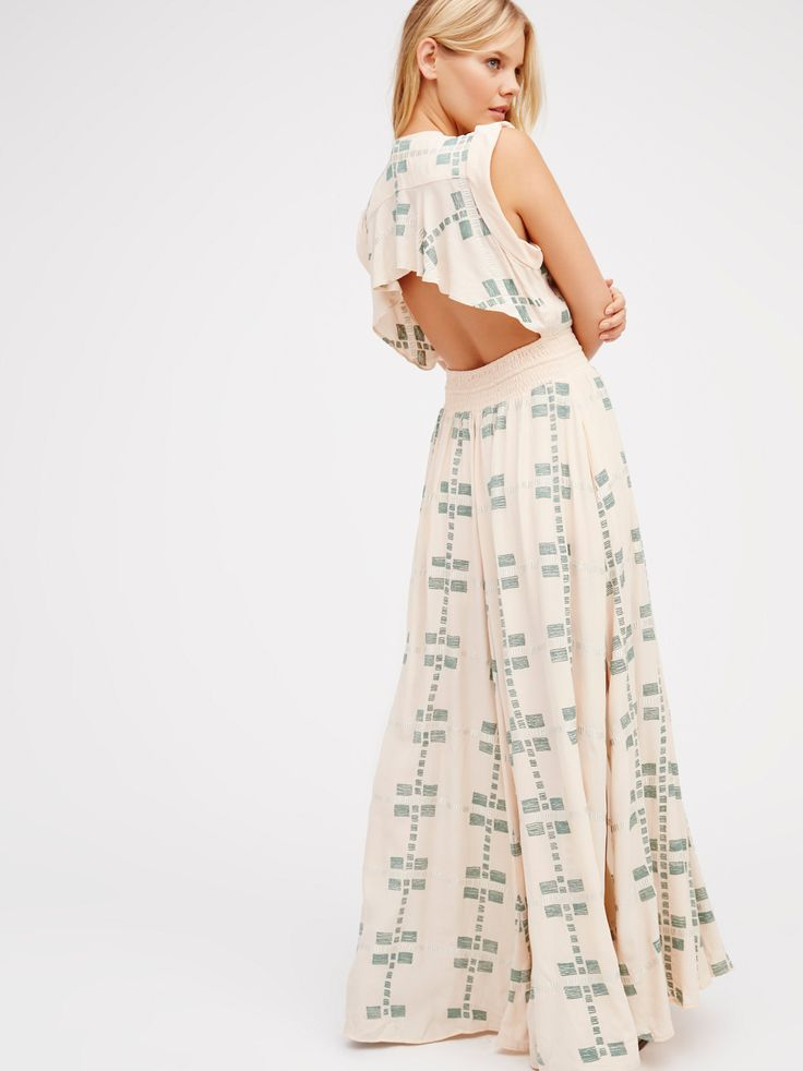 Summer Flame Maxi | Gorgeous maxi dress with femme embroidery throughout. Features a plunging neckline with an eye-catching back containing a darling ruffled panel and open design. Defined waist has a stretchy smocked band with decorative button closures and a tasseled drawstring tie. Front slits. Half lined at the skirt.