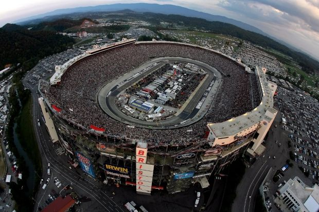 """It's Bristol baby! Hidden in a valley among the Appalachian Mountains sits one of the greatest sports facilities in America.160,000 seats, 43 drivers will compete under the lights in what has come to be known """"The Last Coliseum.""""  While today's track is encased by grandstands and suites, the """"World's Fastest Half Mile"""" has gone through a host of changes over the years."""