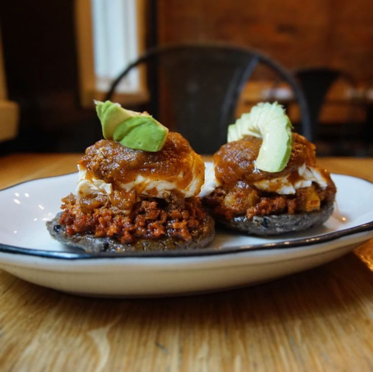 Two fried corn masa cakes -- each topped with frijoles, bits of Berkshire chorizo, a beautifully poached egg, dollop of salsa ranchera and slices of ripe avocado.