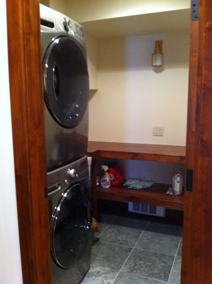The new Laundry Room is smaller now but with the stacking Washer/Dryer we able to add a folding table with storage below and there is even a utility sink in the room!