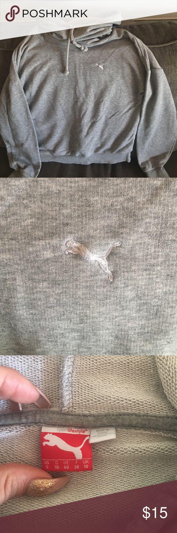 Puma sweatshirt Cozy puma sweatshirt. Slouchy hood with draw strings. Strings show light wear but over all condition is fantastic! Puma Tops Sweatshirts & Hoodies