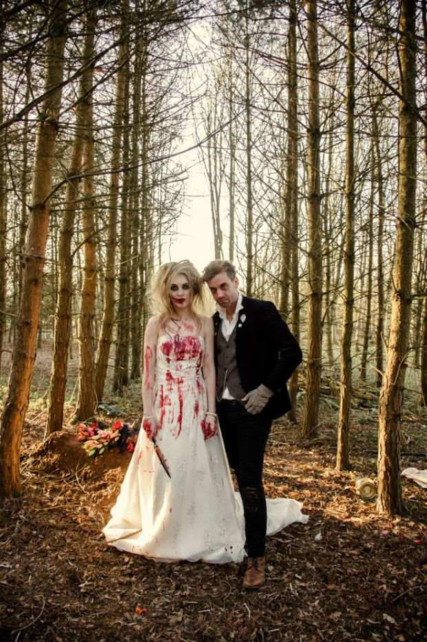 Blood stained zombie bride and groom in the woods by Halo and Hobby Hair and makeup by Tania Claire