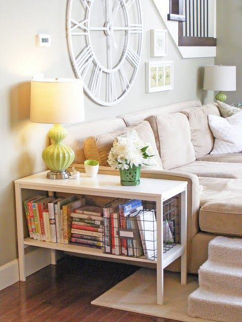 love the large top of this end table with all the storage underneath - because it fits just exactly with the side of their sofa it takes up less space than a standard table would