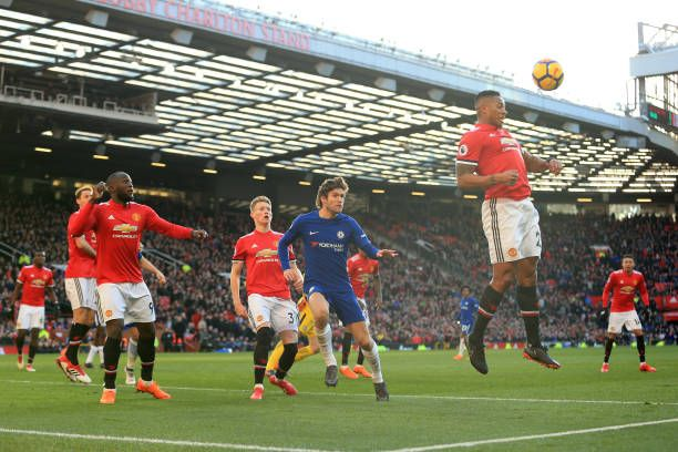 Luis Antonio Valencia of Man Utd heads clear from Marcos Alonso of Chelsea during the dying minutes of the Premier League match between Manchester...