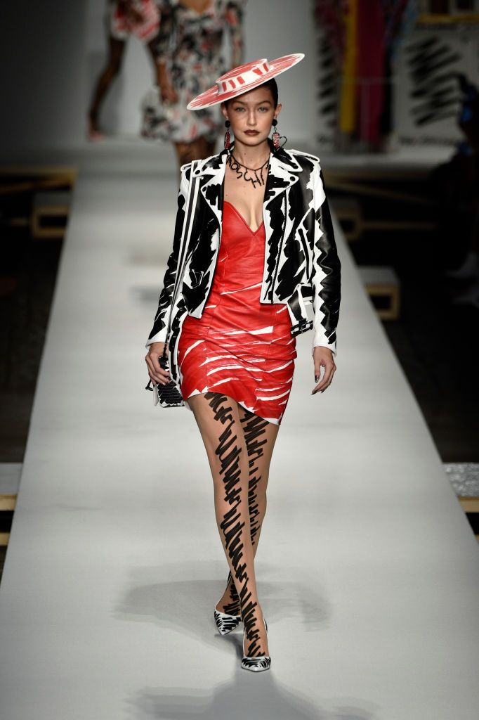 2ddfc80709b Gigi Hadid walks the runway at the Moschino show during Milan Fashion...