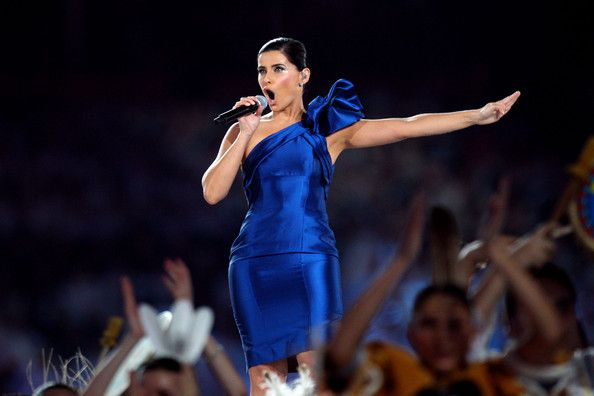 Nelly Furtado Photos Photos - Nelly Furtado performs during the Opening Ceremony of the 2010 Vancouver Winter Olympics at BC Place on February 12, 2010 in Vancouver, Canada. - Olympics - Opening Ceremony