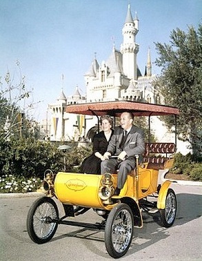 * m. Walt Disney and wife riding in antique auto at Disneyland ca 1960s