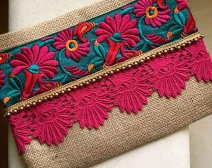 Bohemian clutch, Ethnic Clutch, Womens Bag, Mothers day Gift, Evening Bag, Grey Clutch, Boho Style, Indian Style, Floral Bag, Clutch Purse A fashion statement that everyone will swoon over! This floral clutch will bring elegance to your style. It will be chic with jeans or dresses and you may use this clutch bag both day and night. This clutch bag is perfectly handmade with high quality grey jute fabric. Designed with a silk bohemian embroidery and a tassel. Clutch has a pink silk satin…