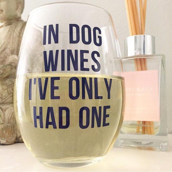 "Delightful logos and sayings printed based on your preferences!This 15 oz wine glass reads ""In Dog Wines, I've Only Had..."