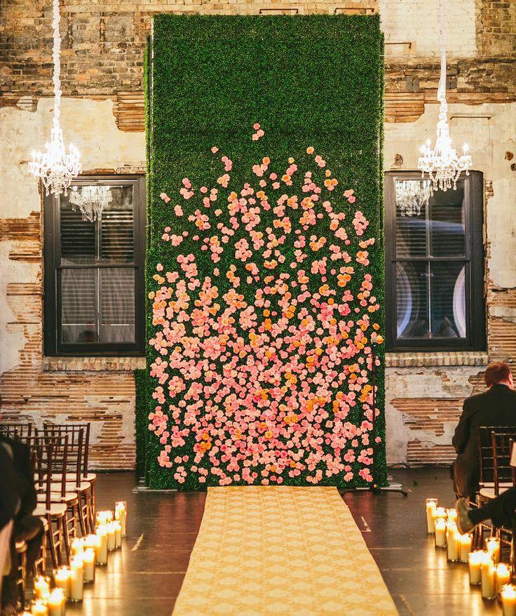 Flower Backdrop   20 Unexpected Wedding Flower Ideas   https://www.theknot.com/content/unique-wedding-flower-ideas