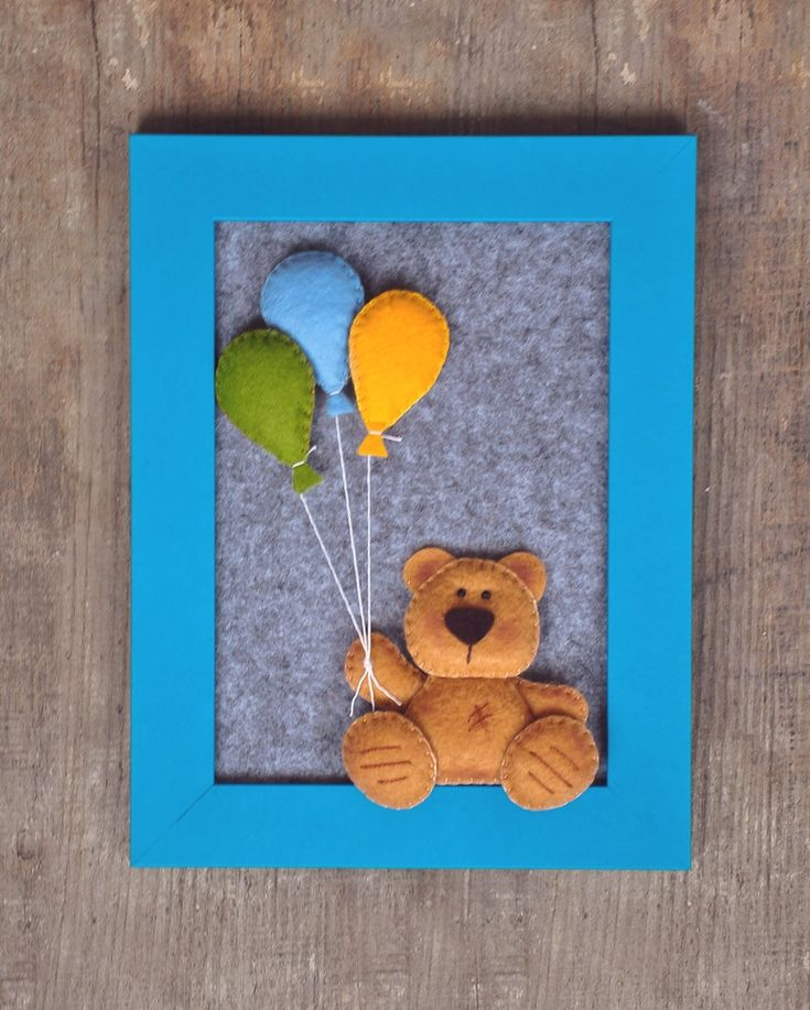 This sweet little Teddy Bear is holding a bunch of balloons. This lovely present for a new baby you can hang on a wall or put it on a shelf. Its made of felt and glued on a thick felt, with 3d effect.  Frame measures 6.5 x 8.5 inches (17 x 22 cm) Teddy is approx 3 inches (8 cm) tall.  Little teddy is hand cutted and hand stitched, made from felt, filled with polyester stuffing.  And, yes! I SHIP WORLDWIDE!  * * * N O T E * * * This is NOT A TOY!!! Because of the little felt pieces I kindly…