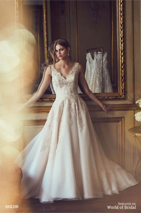 Romance and whimsy pair perfectly with this sweeping gown. BHLDN can't resist the elegant, full silhouette and soft blush hue, especially worn with classic jewelry. It's truly breathtaking, and perfect for a traditional bride who also wants something unique.