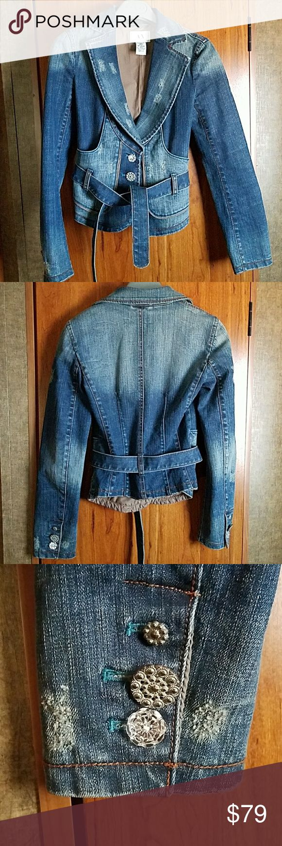 """Armani exchange distressed Jean Jacket SZ XS Authentic Armani Exchange Jean Jacket size XS Pretty buttons - Front has 2 pockets/ 3 button belted  Each Sleeve has 3 buttons/ fully lined  2% Spandex  CHEST: 15"""" flat lay across from arm pit to arm pit  LENGTH: 20"""" SLEEVE: 24"""" LIKE NEW CONDITION!!!! Armani Exchange Jackets & Coats Jean Jackets"""