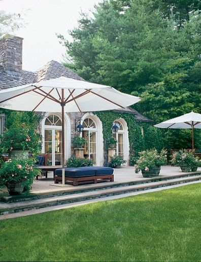 Such a pretty patio. Especially the ivy covered exterior and arched windows.