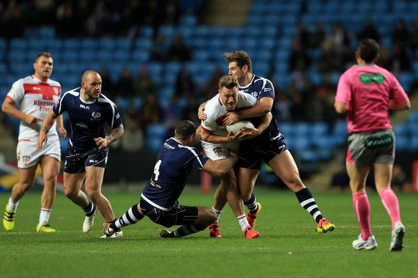 Canberra Raiders Elliott Whitehead of England competes with Ben Hellewell and Kane Linnett of Scotland during the Four Nations match between the England and Scotland at The Ricoh Arena on November 5, 2016 in Coventry, United Kingdom.