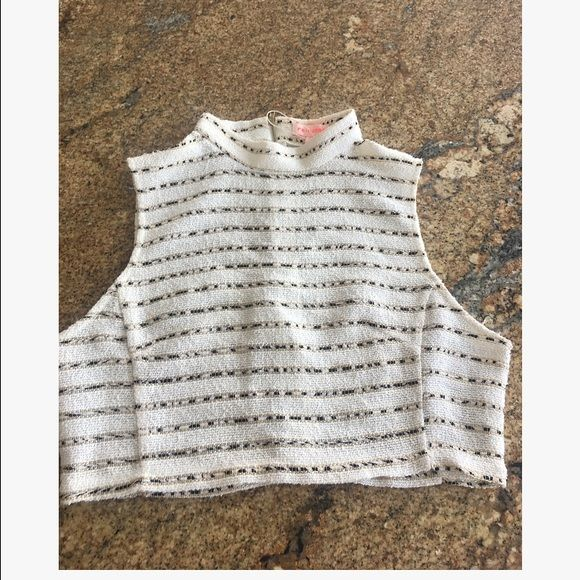 Knit Crop Top Never Worn bought for a Chanel Halloween costume! Super cute cream crop top the gold thread is sparkly which makes it even more pretty! re named  Tops Crop Tops