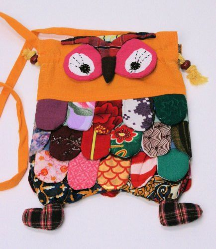 Calling those kids that love owls! Here is a fun colorful handbag with a strap made from handcrafted fabric in lots of fun colorful patterns. The bag has strings that cinch together for easy opening and closing, and it has a long strap that could be worn across the body.