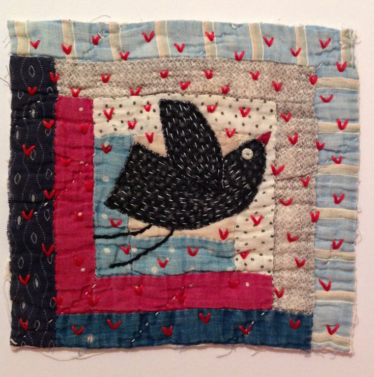 Embroidered bird onto antique quilt piece by Naomi Hutchinson - The underground stitcher