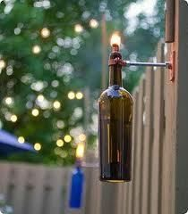 Recycled Wine or Beer Bottle Hanging Tiki Torch Lights with mountable clamps from Home Dept going to use old liquor  bottles for mine and they are accumulating by leaps and bounds around here.