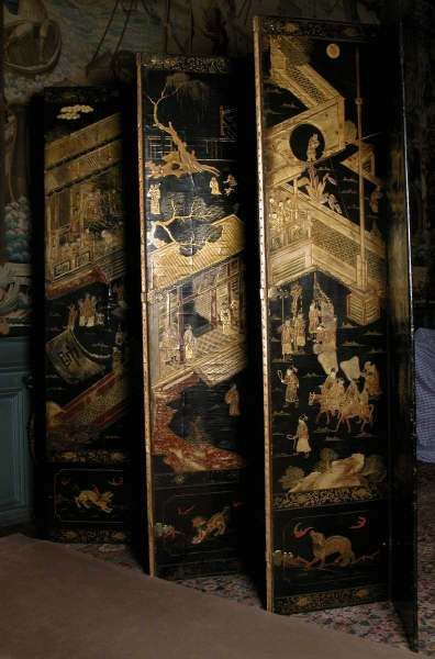 Chinese black lacquer screen, late 17th century, with English mounts of c. 1715. ©National Trust Collections