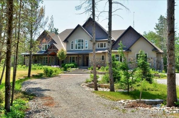 Carrie Underwood and Mike Fisher have listed their 11-acre, five-bedroom, five-bathroom Canadian estate. For more information and photos, visit the website of real estate agent Paul Rushforth. Visit GACTV.com for the full gallery.