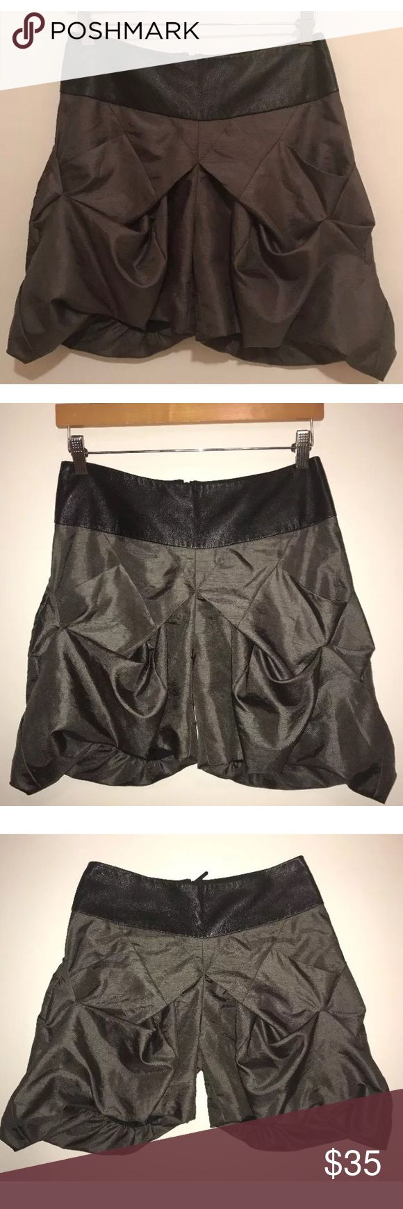 """Sally Phillips Blouson Shorts Faux Leather Waist Sally Phillips -Adelaide Fashion Designer Gray Blouson Shorts with Black Faux leather Waistband Sz. 6 EUC So Chic. No stains, tears, rips or holes. (No Trades)  Waist side to side 14""""  Length (top back waist to bottom) 17""""  Be sure to check out my other items! Sally Phillips Shorts"""