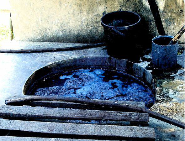 Indigo dye vat. The more dips the intensity of the blue. For a navy you need about 20 dips.