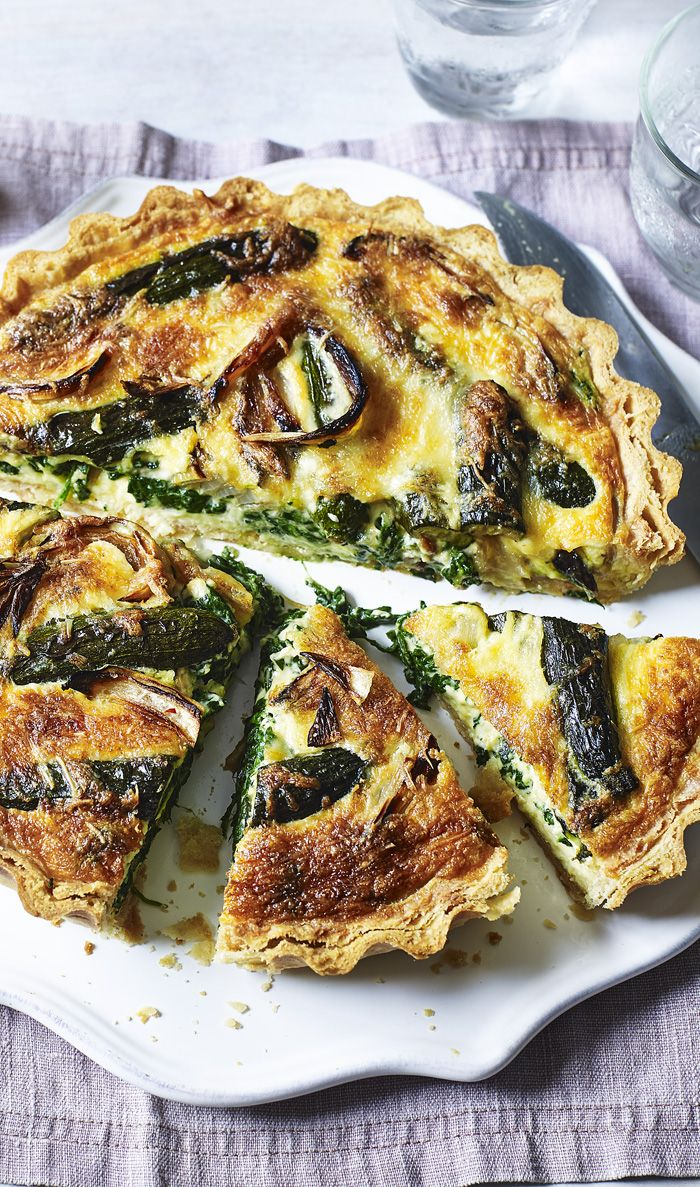 Roasted onions, courgettes and spinach pack out this tart flavoured with gruyere. By Mary Berry.