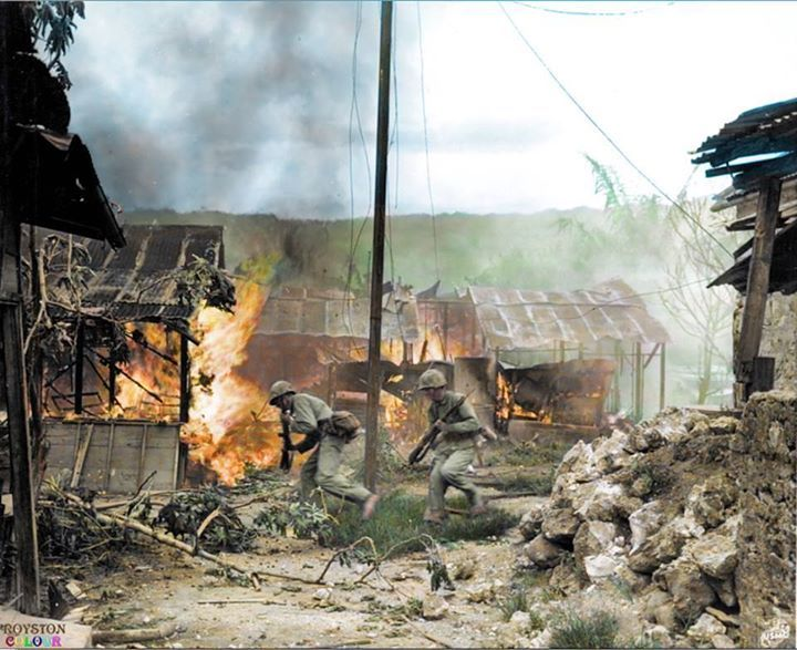 "Garapan, Saipan, Mariana Islands. 3rd of July 1944. ""Marine infantrymen move fast to take up new positions in Garapan, principal city of Saipan. Japanese buildings and installations were set afire by supporting artillery barrages and the 'Leathernecks' (Marines) entered the town to engage the enemy in street fighting for the first time in the Pacific theatre."" Garapan, on the west coast of Saipan, was captured by the 2nd Marine Division."