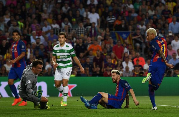 Lionel Messi of Barcelona scores his third and his sides fifth goal during the UEFA Champions League Group C match between FC Barcelona and Celtic FC at Camp Nou on September 13, 2016 in Barcelona, Catalonia.