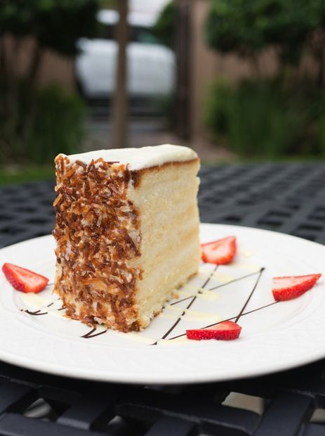 This coconut cake alone is worth a trip to Charleston. It's served at the famed Peninsula Grill at the Planters Inn—a golden and towering 12-layer creation of vanilla-accented pound cake and whipped coconut cream.
