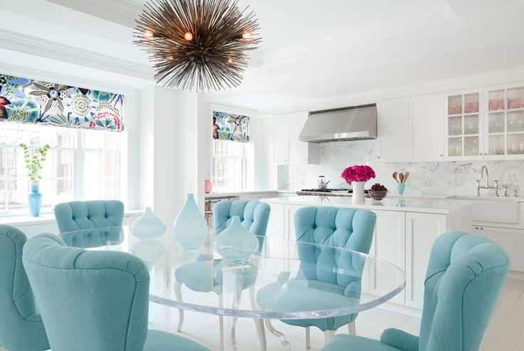 blue dining chairs with Lucite dining table, by Fawn Galli