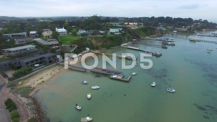 Slow descend over water near many private piers at Sorrento - Stock Footage | by gregbrave