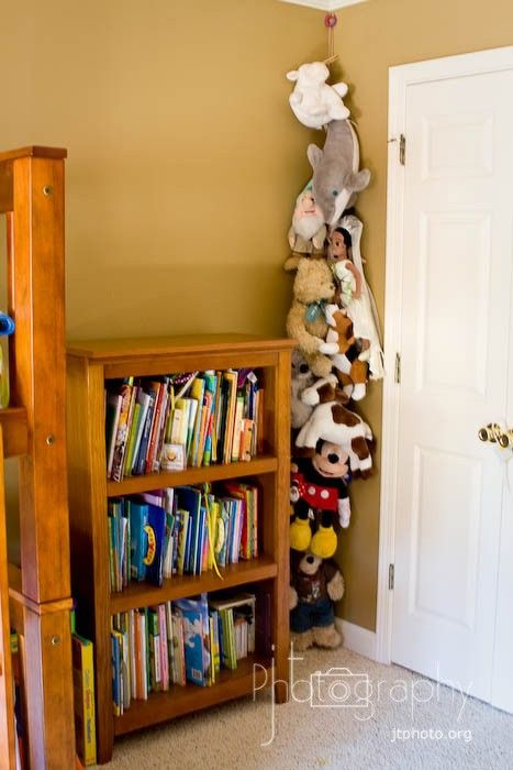 Hang a rope from the ceiling then clip the stuffed animals to it with clothes pins. Nice space saver.