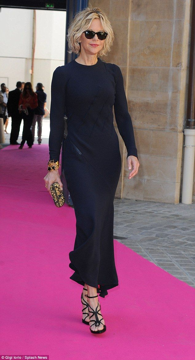 Still the leading lady! Meg Ryan, 53, looked great in a navy gown as she attended theSchiaparelli PFW show