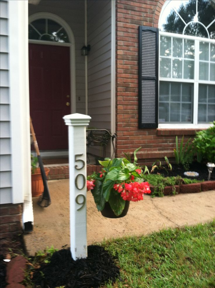 Would love to do something like this with a solar light on post .. House number on post and our name sign instead of plant