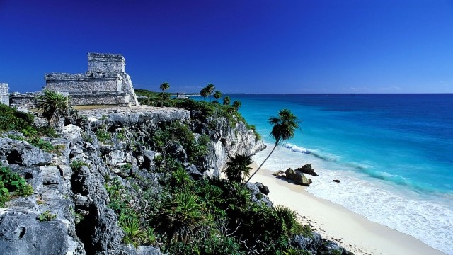 Explore Mayan archaeological sites – Cancun, Mexico.  My whole family just visited this site-so beautiful on the cliffs.