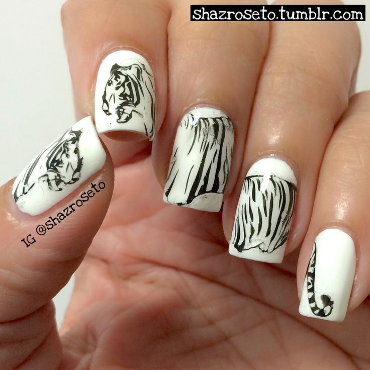 Hear the tigers ROAR Products Used: Base Color: Sally Hansen Xtreme Wear White On Technique: Stamping Plate: Moyou London Suki Collection 01 Stamping Polish: Color Club Where's the Soiree Top Coat: Essie Good to Go